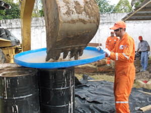 bmt-entech-uses-a-funnel-to-fill-drums-with-soil_0